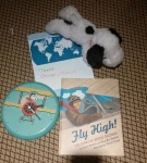 Eloise uses these props while reading Fly High!