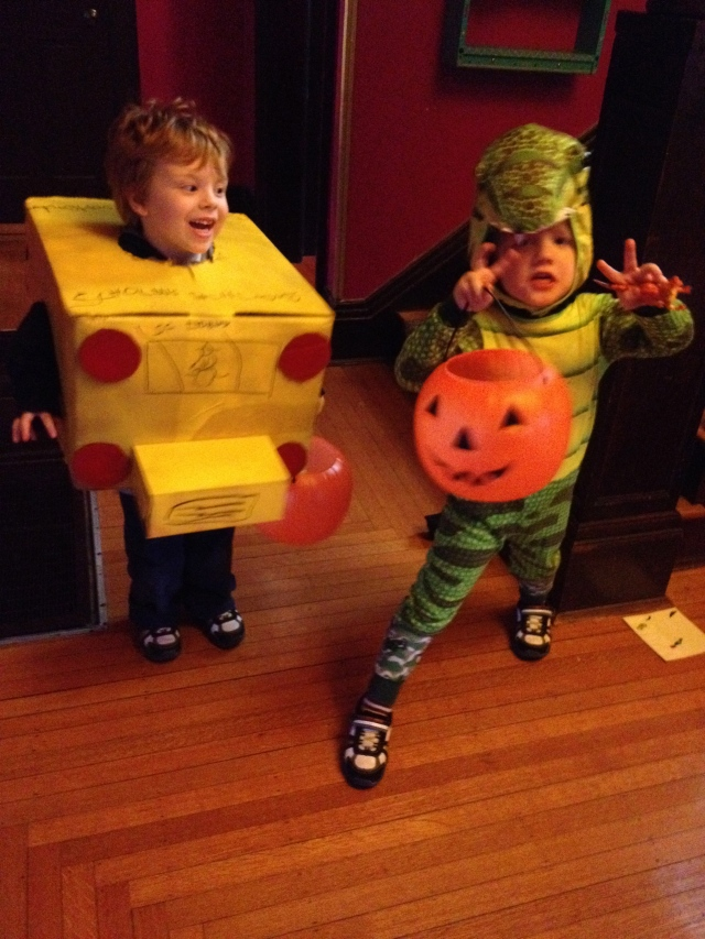 A school bus and his friend T-Rex.